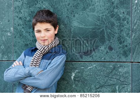 portrait of a casual teen boy, outdoors