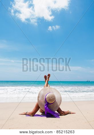 Beautiful woman on the beach with straw hat on the beach in Bali Indonesia
