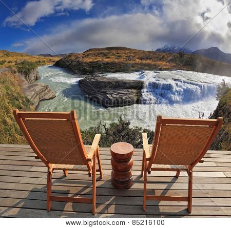 Charming lookout for two. Two convenient comfortable guest sun loungers and a bedside table are worth on a wooden platform. Hence it is convenient to admire cascading waterfall