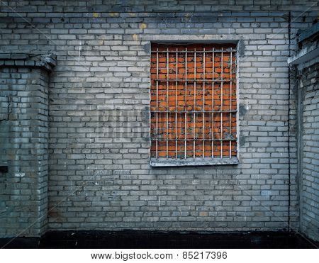 Brick wall background with window made of bricks. Ultimate security against burglary.