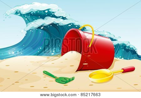 Ocean waves and bucket of sand