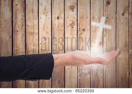 Close up of businessman with empty hand open against wooden planks background