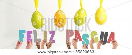 Hands holding up feliz pasqua against four easter eggs hanging from a line
