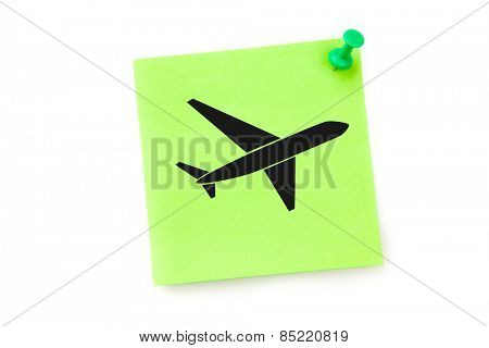 Airplane against green adhesive note