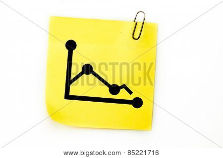 Graph against sticky note with grey paperclip