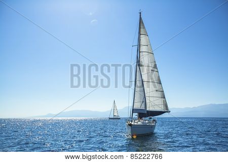 Boat competitor of sailing regatta in clear sunny weather. Luxury yachts.