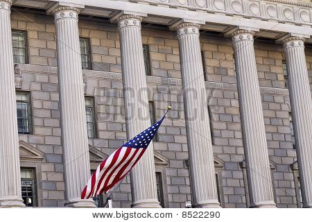 American Flag And Building In Washington Dc