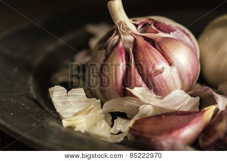 Fresh Garlic Cloves In Moody Natural Lighting Set Up With Vintage Retro Style