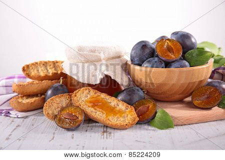 fresh plum, jam and bread