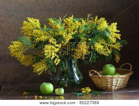 Apples In A Wattled Basket And A Mimosa Bouquet