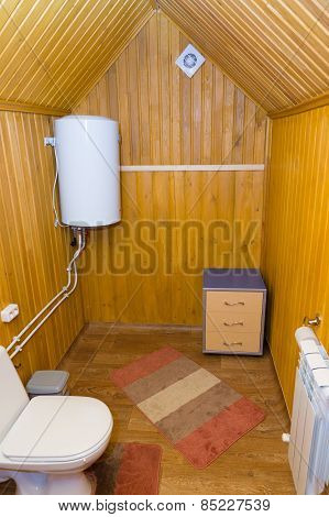 The Toilet Room With A Boiler And A  Table