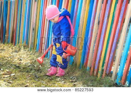 Little Girl Pouring Water With Watering Can