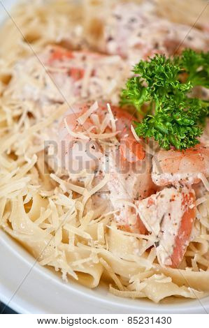 Pasta with shrimp sauce and cheese
