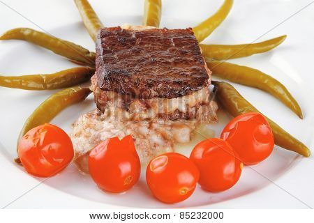 beef meat with melted yellow cheese over white