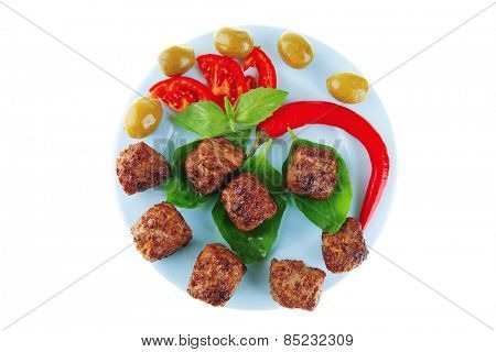 served meat cutlets with basil and tomatoes