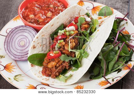 Mexican tortilla wrap, burrito with chili, beans and ground beef
