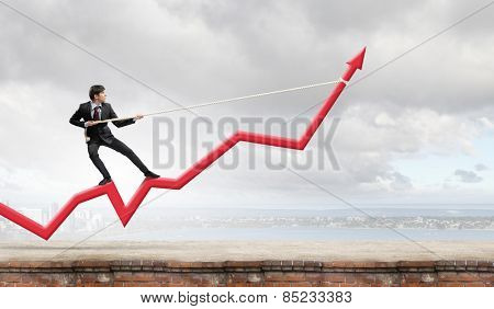 Businessman pulling arrow with rope and making it raise up
