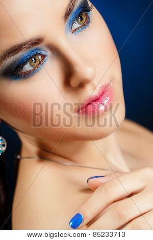 Closeup portrait of a female model with fashion makeup