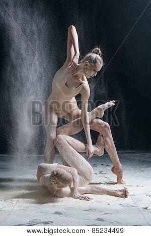 couple of female dancers posing in studio