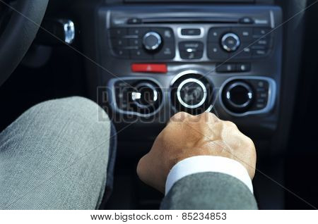 closeup of a young man in suit driving a car with manual transmission