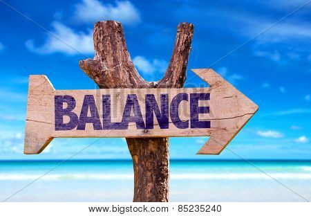 Balance wooden sign with beach background