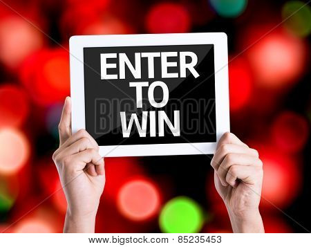 Tablet pc with text Enter to Win with bokeh background