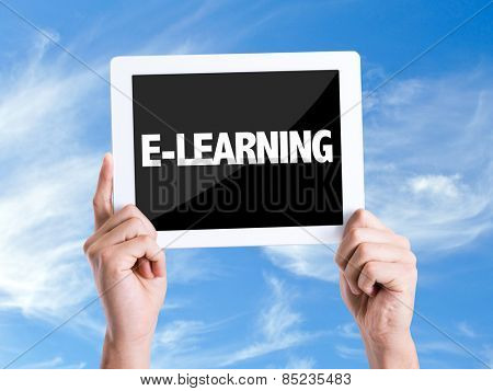 Tablet pc with text E-Learning with sky background