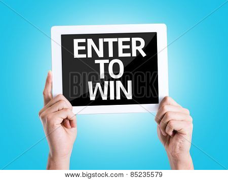 Tablet pc with text Enter to Win with blue background