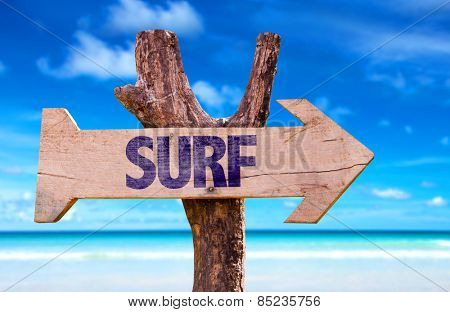 Surf wooden sign with beach background