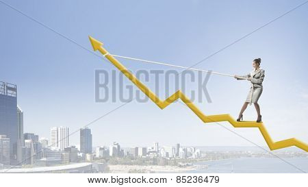 Businesswoman pulling arrow with rope and making it raise up