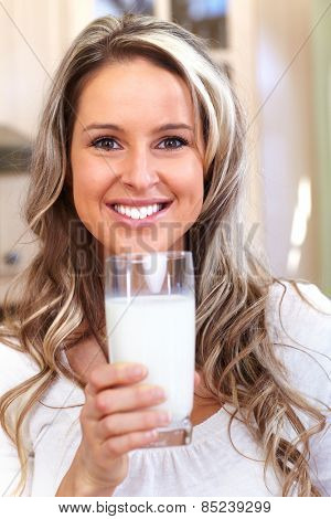 Young woman drinking milk. Health and diet.