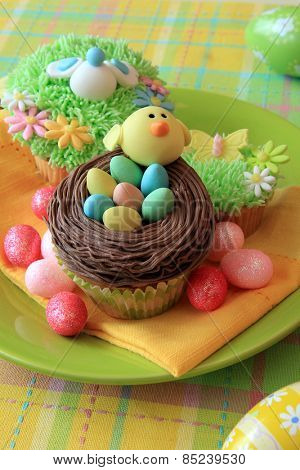 Easter cupcake with Easter eggs and a chick made of fondant.