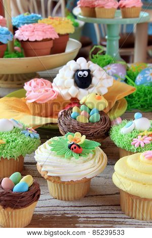 Easter cupcake display at a bakery. Shallow dof, focus on the front cupcakes.