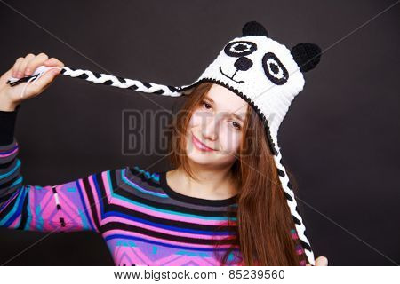 studio portrait of brunette girl in hat panda