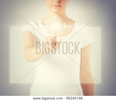close up of woman hand touching virtual screen