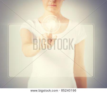 close up of woman hand touching virtual screen