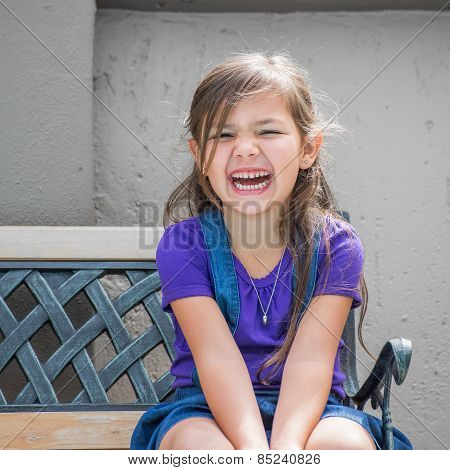 Little Girl On Bench