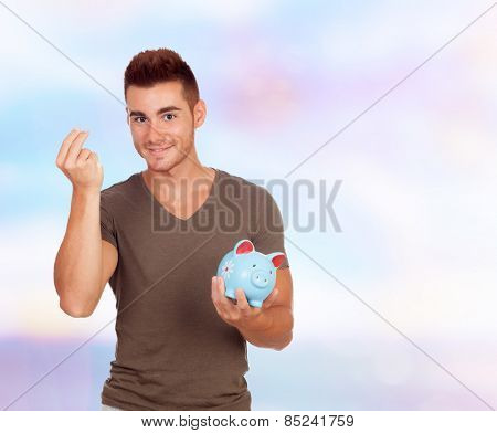 Cool young men with a money box on a blue background