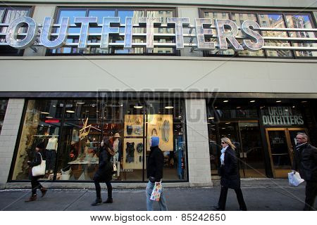 NEW YORK CITY - FEB. 25, 2015:  Pedestrians walk past an Urban Outfitters store. Urban Outfitters, Inc. is an American clothing corporation headquartered in Philadelphia, Pennsylvania.