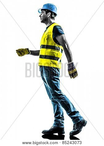 one construction worker walking with safety vest silhouette isolated in white background