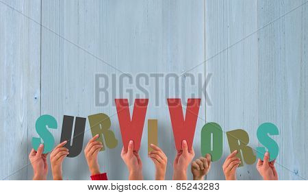 Hands holding up survivors against wooden planks