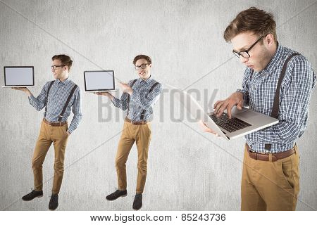 Nerd with laptop against white and grey background