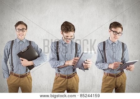 Nerd with tablet pc against white and grey background