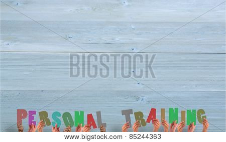 Hands holding up personal training against bleached wooden planks background