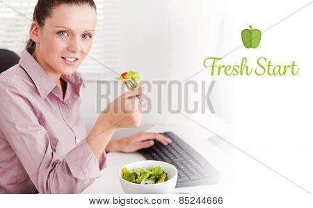 The word fresh start against businesswoman in office eating salad