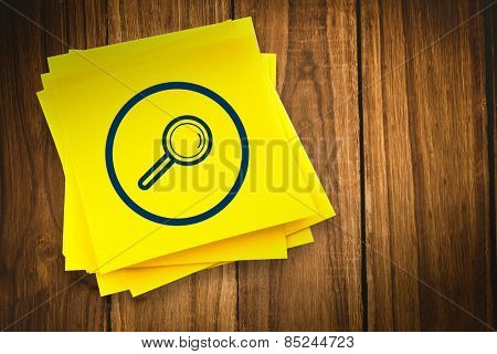 Magnifying glass graphic against sticky note