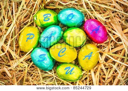 boa pascua against easter eggs grouped together on straw