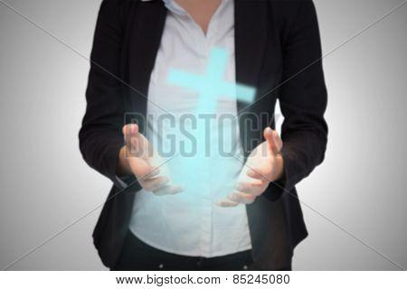 Businesswomans hands presenting against white cross