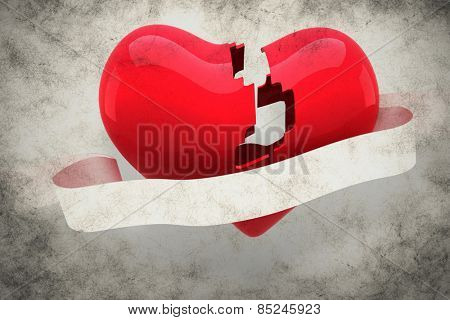 Broken heart against grey background
