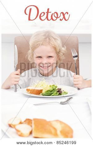 The word detox against portrait of a little boy ready to eat pasta and salad